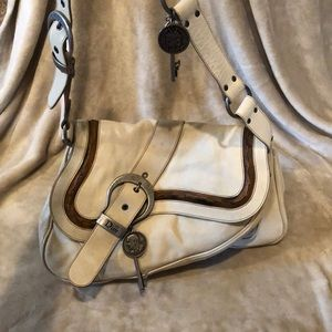 Authentic Dior saddle leather handbag.